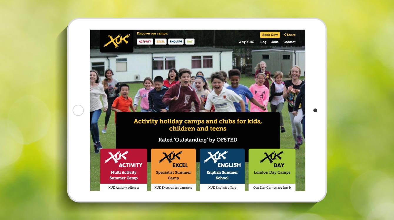 The XUK website homepage on an iPad - desktop