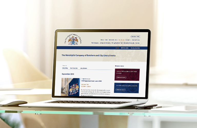 The Worshipful Company of Butchers website on a laptop - mobile