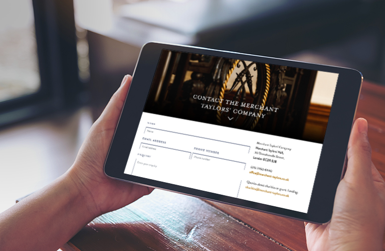 Merchant Taylors' Company Contact webpage on an iPad - mobile